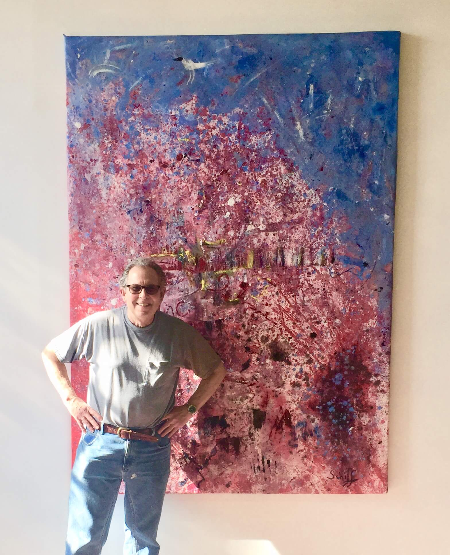 Mark Schiff in front of painting